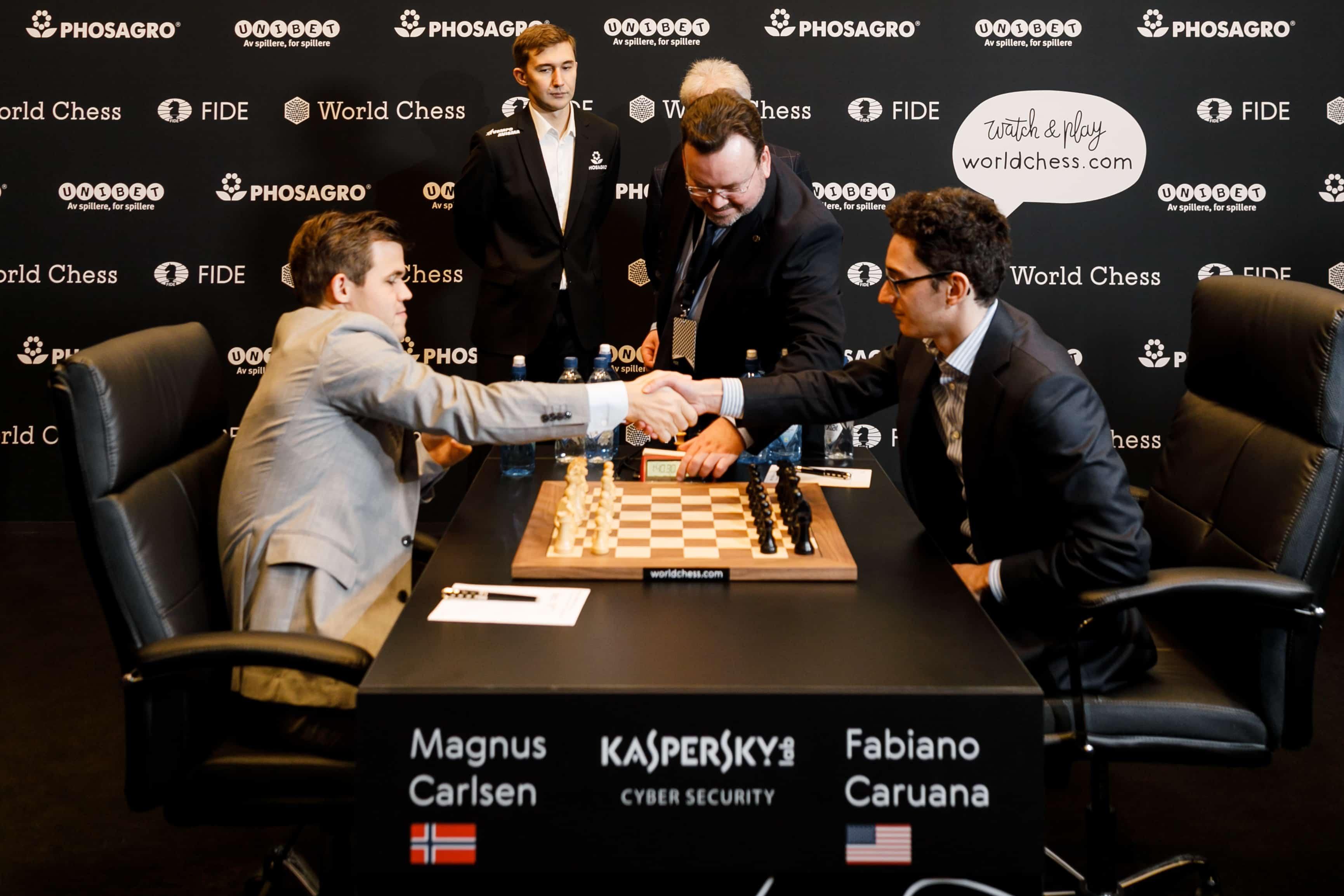 Magnus Carlsen and Fabiano Caruana shake hands to start Game 11