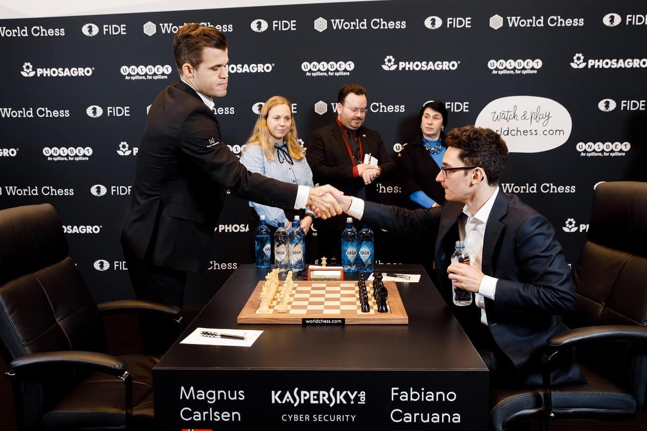 Magnus Carlsen and Fabiano shake hands before the start of Round 4