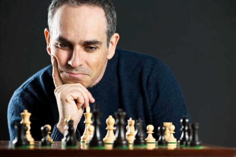 a man thinking at the chessboard